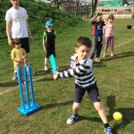 holiday club Young boy in striped black & white top about to hit ball at LW session