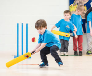 cricket fun for kids blog young boy with yellow bat