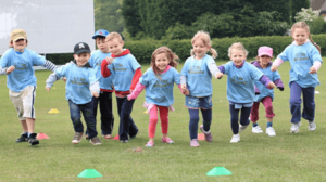 healthy active confident kids little wickets session running and smiling