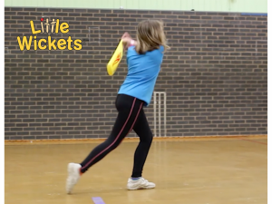 Annie playing cricket to highlight August 2019 blog post on healthy active and confident kids